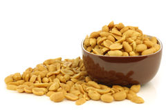 Tasty peanuts in a brown bowl Stock Image