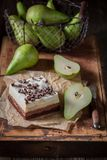 Tasty pear cake with fresh fruits on old wooden box Royalty Free Stock Images