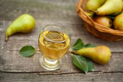 Tasty pear juice in glass Royalty Free Stock Photo