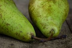 Tasty pears in a jute sack lying on a wooden kitchen table. Frui Royalty Free Stock Images