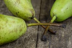 Tasty pears in a jute sack lying on a wooden kitchen table. Frui Royalty Free Stock Photography