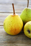 Tasty pears on a wooden table Stock Image