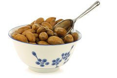 Tasty pecan nuts in a ceramic bowl Royalty Free Stock Image