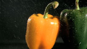 Tasty peppers in super slow motion receiving water stock video footage
