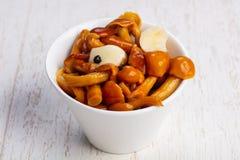 Tasty pickled mushrooms Stock Images