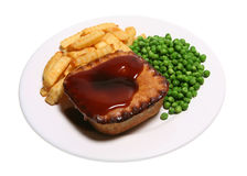 Tasty Pie. Meat pie with gravy, crinkle-cut chips and garden peas isolated on white Royalty Free Stock Photography