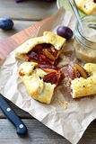Tasty pie with plums on the board Royalty Free Stock Image