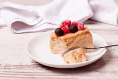 Tasty piece of cake with berries in saucer Royalty Free Stock Photography