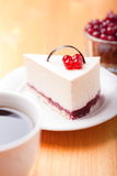 Tasty piece of cake with berries in saucer Royalty Free Stock Images