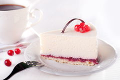 Tasty piece of cake with berries in saucer Royalty Free Stock Image