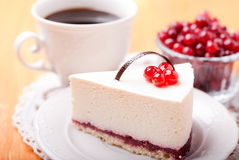 Tasty piece of cake with berries in saucer Royalty Free Stock Photo
