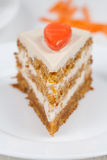 Tasty piece of homemade carrot easter cake with Royalty Free Stock Images