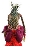 Tasty pineapple. An image of a little girl with a tasty pineapple royalty free stock photos