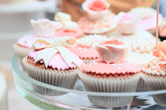 Tasty pink cakes on glass dish Stock Image