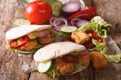 Tasty pita with chicken nuggets, cucumber, nappa cabbage, onion Stock Photography