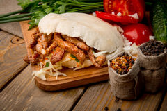 Tasty pita. With fresh salad on wooden table stock images