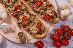 Tasty Pizza Baguette with Mushrooms and Parmesan Ingredients royalty free stock photos