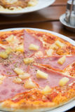 Tasty pizza with ham and cheese. Stock Image