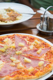 Tasty pizza with ham and cheese. Selective focus. Stock Photo