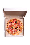 Tasty pizza with ham and tomatoes in box Stock Photo