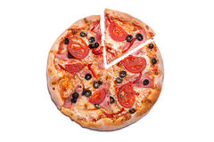 Tasty pizza with ham and tomatoes with a slice removed Stock Image