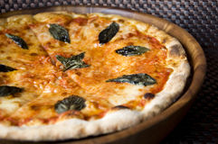 Tasty pizza Margherita. Close up tasty pizza Margherita on wooden pan Stock Photo