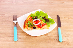 Tasty pizza with olives and cutlery Stock Photo