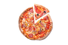 Tasty pizza with pepperoni and mushrooms with a slice removed Stock Photography