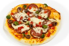 Tasty pizza salami. Taste the delicios pizza made from salami, mozzarella, mushrooms, and vegetables royalty free stock photo