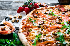 Tasty pizza on table Stock Images