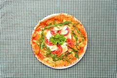 Tasty pizza on a tablecloth royalty free stock images