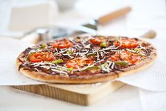 Tasty pizza with tomato chesse olive Stock Images