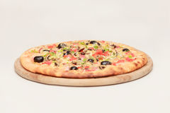 Tasty pizza with vegetables, chicken and olives Stock Photography