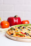 Tasty pizza with vegetables. Chicken and olives on white Stock Photography