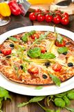 Tasty pizza on wooden table, top view. stock photography
