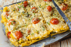 Tasty polenta with cheese on the board Royalty Free Stock Image