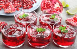 Tasty pomegranate juice in gkass cups stock photography