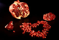 The tasty pomegranate looks as heart Stock Image