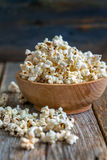 Tasty popcorn in a wooden cup. Stock Image