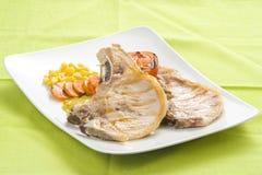 Tasty pork chop with corn carrot tomato Stock Image