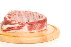 Tasty Pork ribs on round hardboard Royalty Free Stock Photo