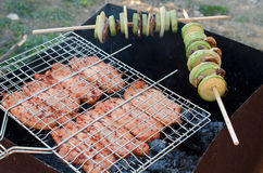Tasty pork with vegetables on grill Stock Photography