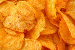 Tasty potato crisps  background Stock Image