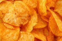 Tasty potato crisps  background Stock Image