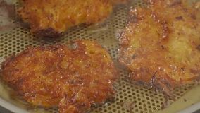 Tasty potato fritters stock video footage
