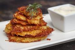 Tasty potato pancakes or latke with sauce. On white plate, closeup Royalty Free Stock Image