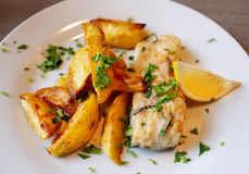 Tasty potatoes with fish Royalty Free Stock Photography