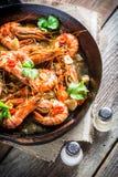 Tasty prawns served on hot pan Stock Image