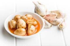 Tasty preserved garlic. Royalty Free Stock Photos