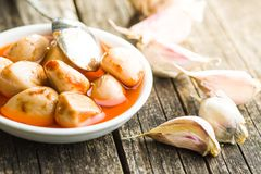 Tasty preserved garlic. Royalty Free Stock Photography